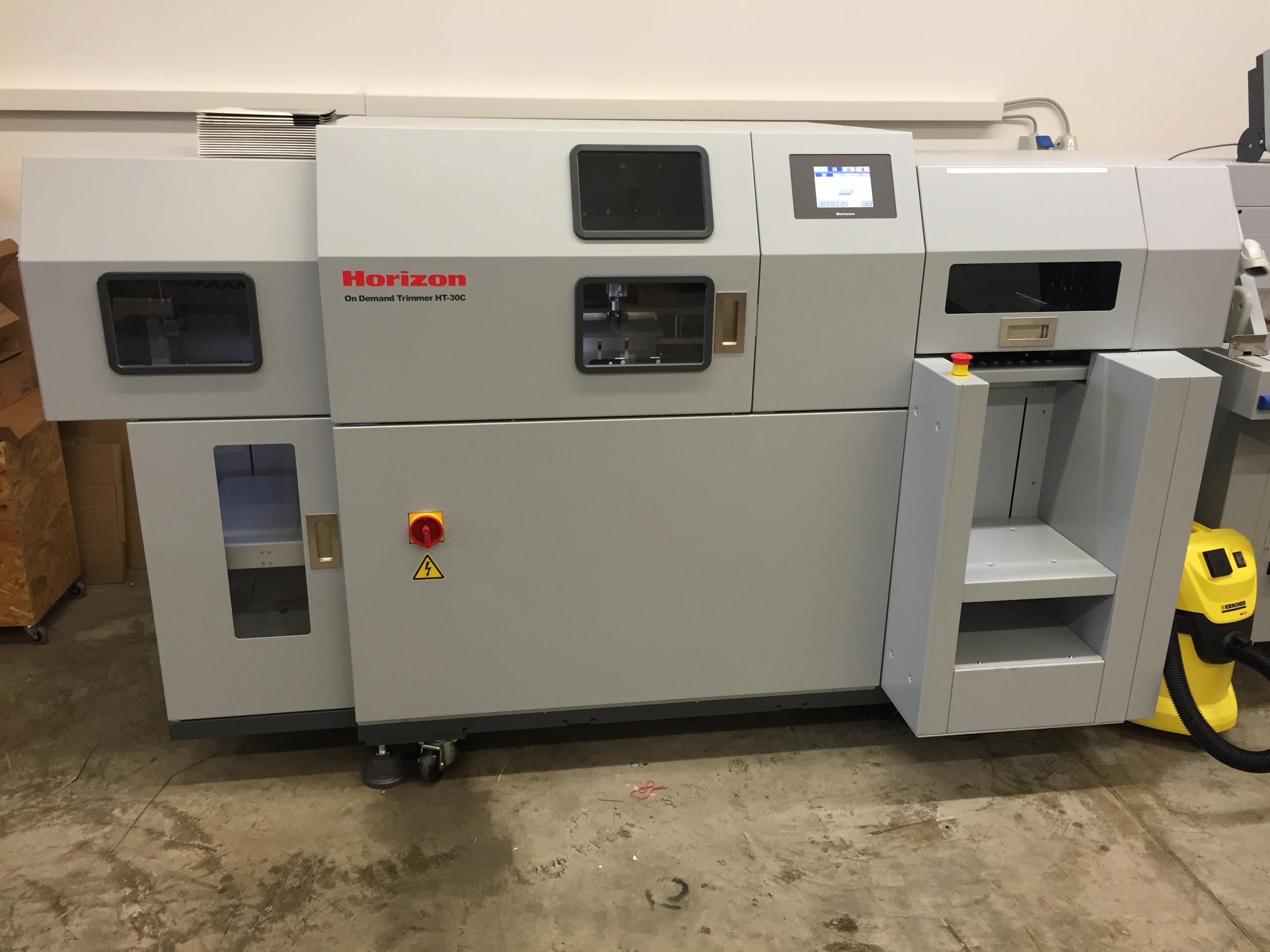 Schneideautomat für sauberen Beschnitt auf Endformat